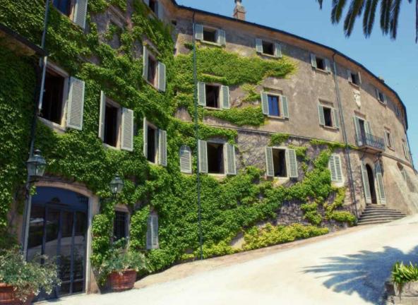 entrance of a destination wedding castle in florence
