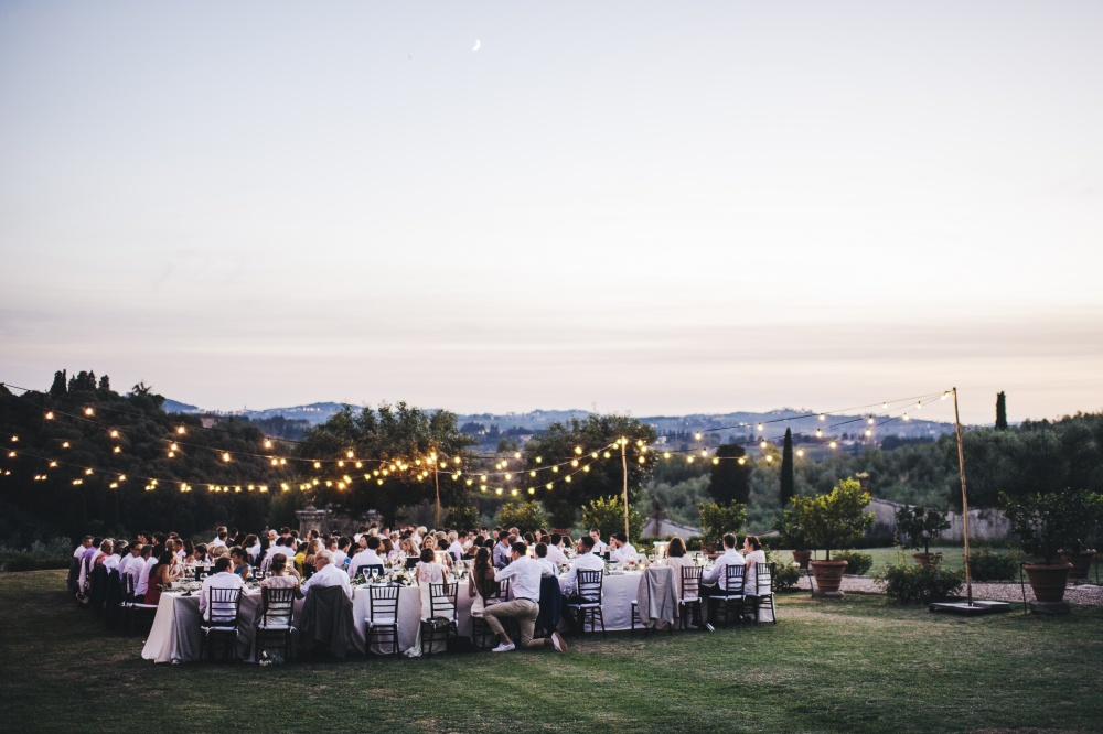 destination wedding villa in florence tuscany dinner setting with bulblights