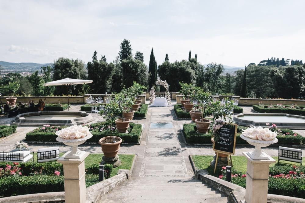 destination wedding luxury hotel in florence symbolic ceremony setting with flowers