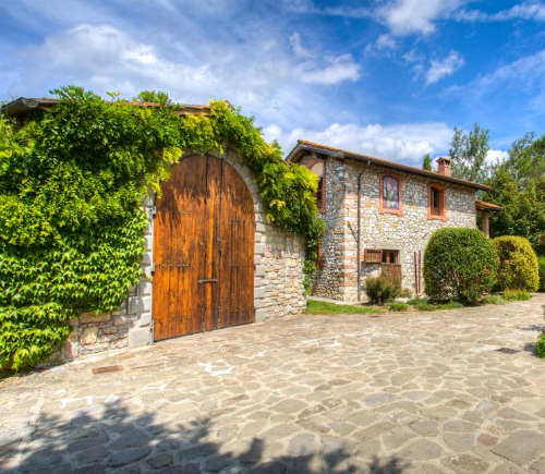 big wooden door entrance in a hamlet in tuscany italy