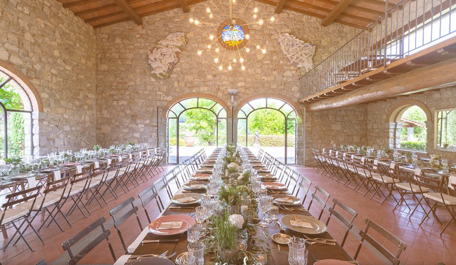 wedding dinner setting in an indoor room in a dream hamlet in tuscany