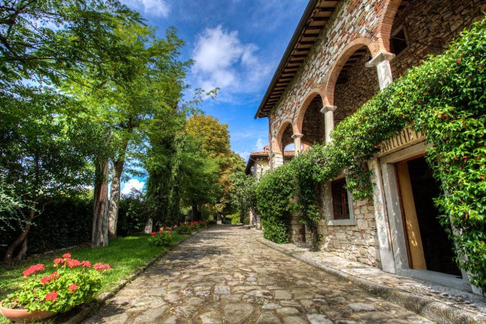 dream wedding hamlet with greenery in tuscany