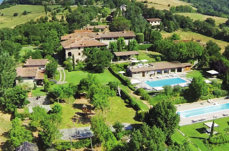 aerial view of a hamlet and its pool areas for weddings in tuscany italy
