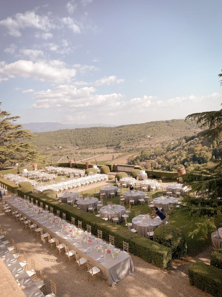 hindu weddings in tuscany dinner setup with view in a luxury venue in lucca