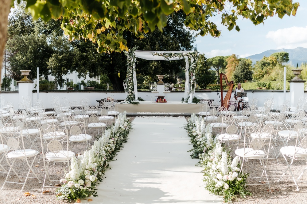 hindu wedding in tuscany ceremony setting with flowers