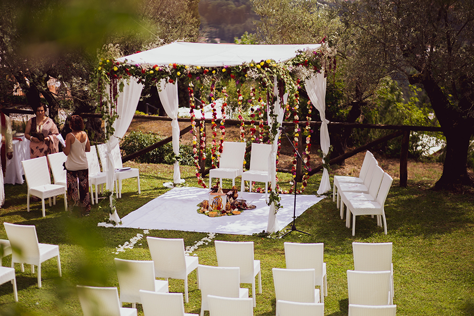 indian ceremony setting in the garden of a luxury venue in Lucca