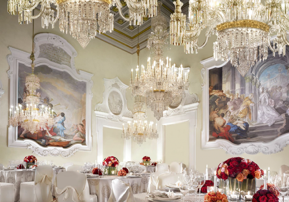 a beautiful ballroom with chandeliers in an amazing wedding villa in Florence