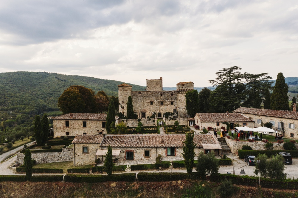 aerial view of a medieval castle for wedding in chianti tuscany