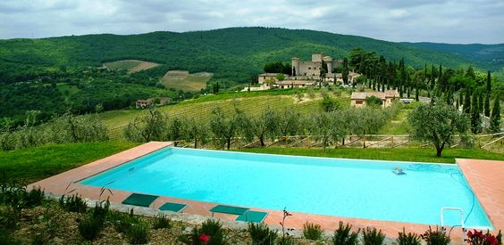pool area with view in a medieval castle in chianti tuscany
