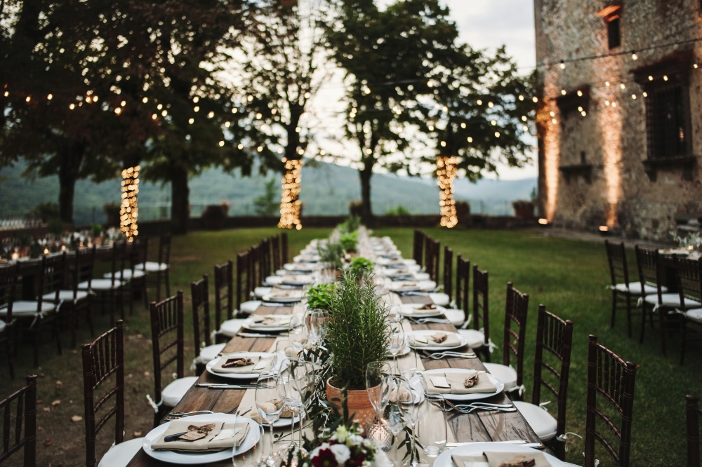 wedding table setting in a medieval castle in chianti tuscany