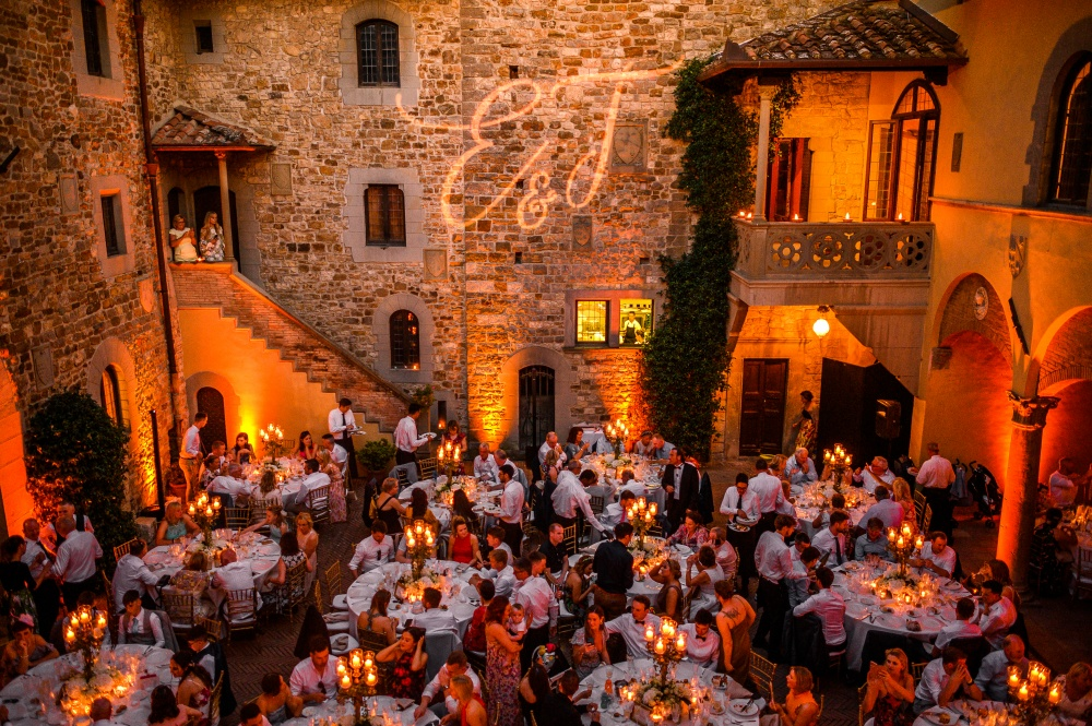 medieval wedding castle dinner with uplights in the courtyard