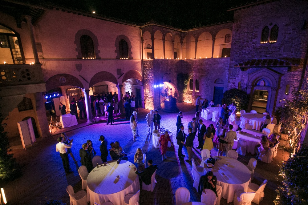wedding dancing party with lights in a medieval castle in chianti tuscany