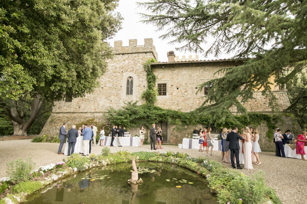 garden with fountain for wedding events in a medieval castle in chianti tuscany