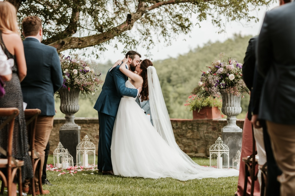 outdoor ceremony in tuscany in a garden with flower pots