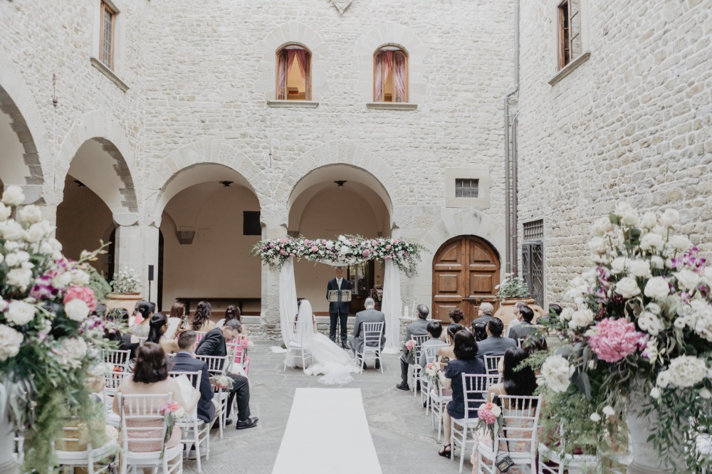 outdoor ceremony in tuscany courtyard of a wedding villa