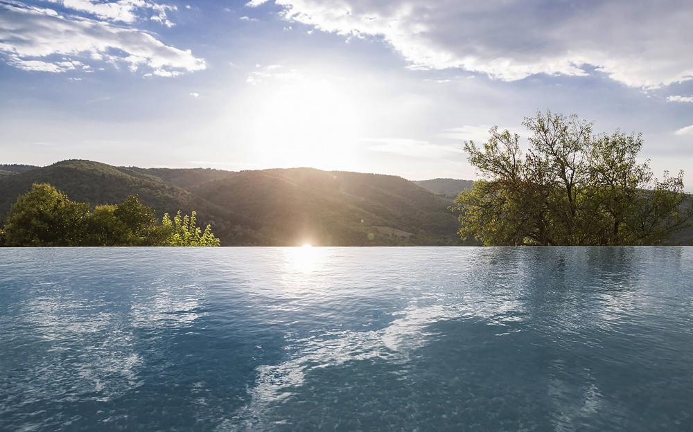 infinity pool with view in a precious wedding hamlet in tuscany