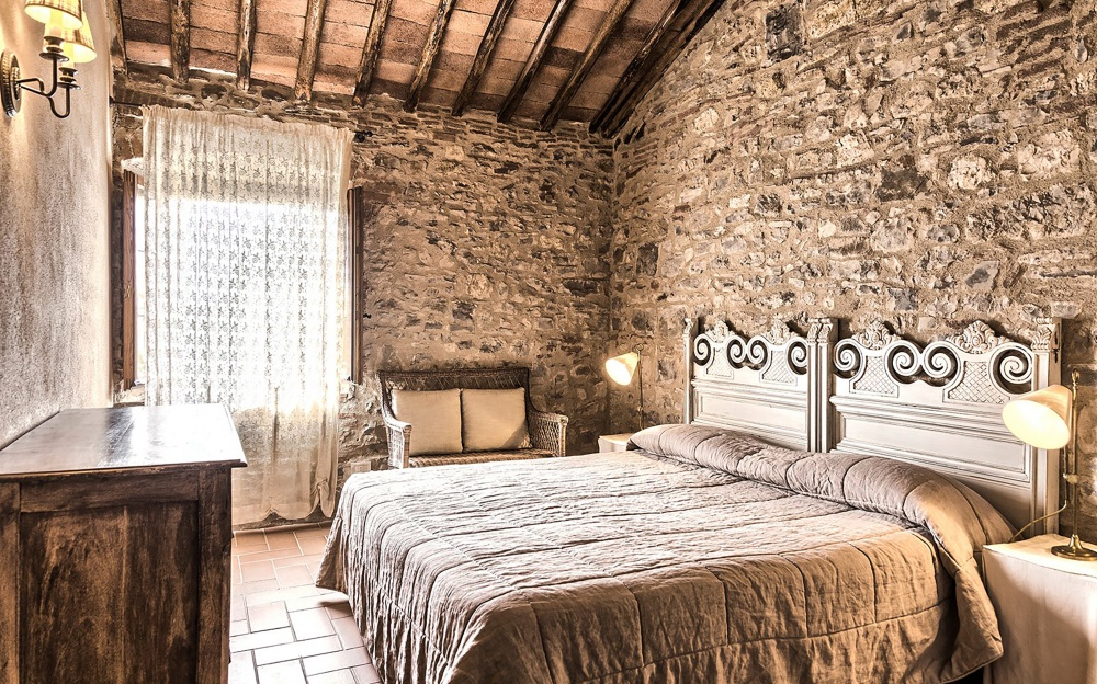 room with bricks walls in a precious hamlet for wedding in tuscany