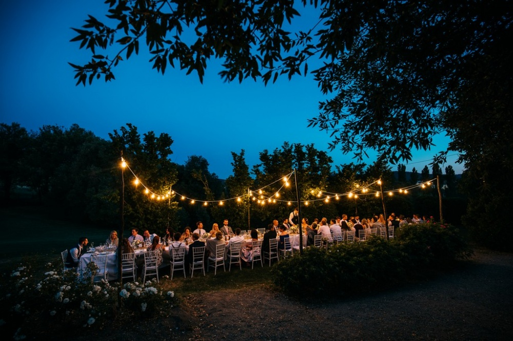 wedding dinner with vintage lights in a romatic villa in siena