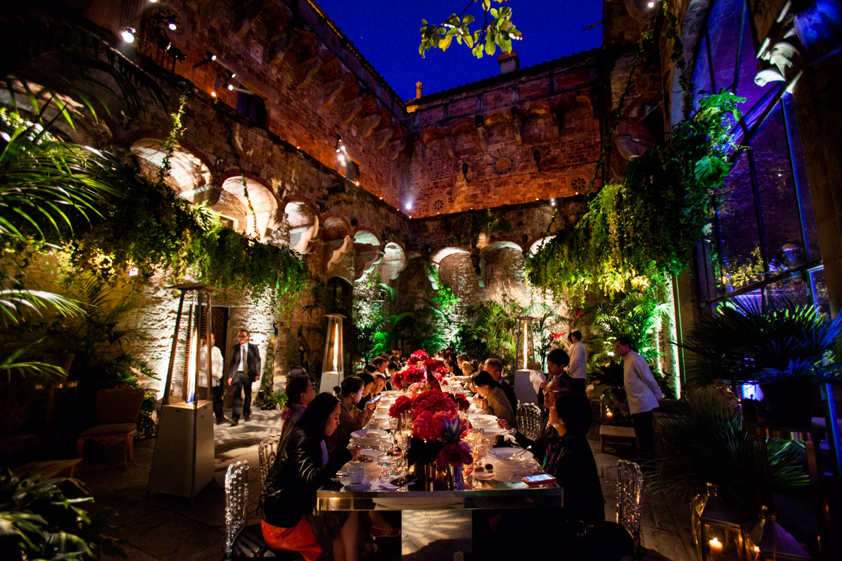wedding dinner in the courtyard of an ancient Tuscan villa