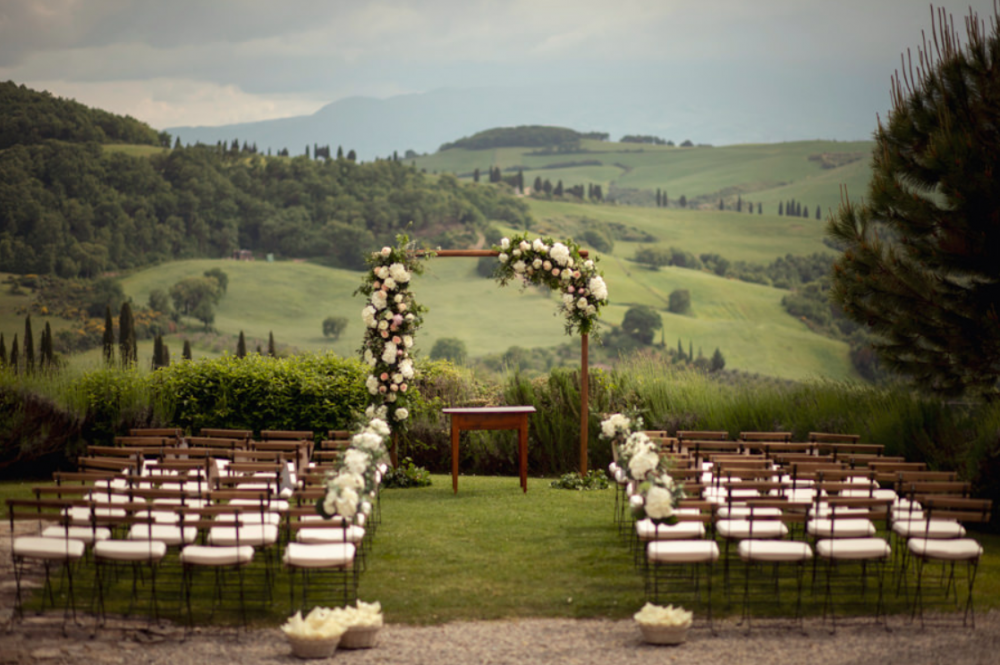symbolic weddings in tuscany wooden chairs
