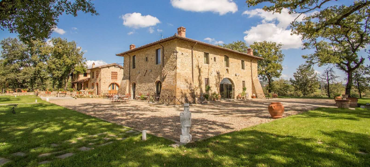 tuscany wedding location entrance of the villa with stone buildings