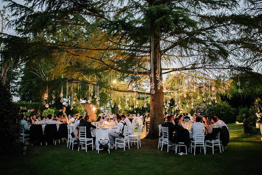 tuscany wedding luxury location with a bulblights dinner setting