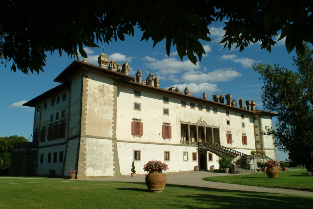 entrance facade and garden view of a medici villa in the tuscan contryside