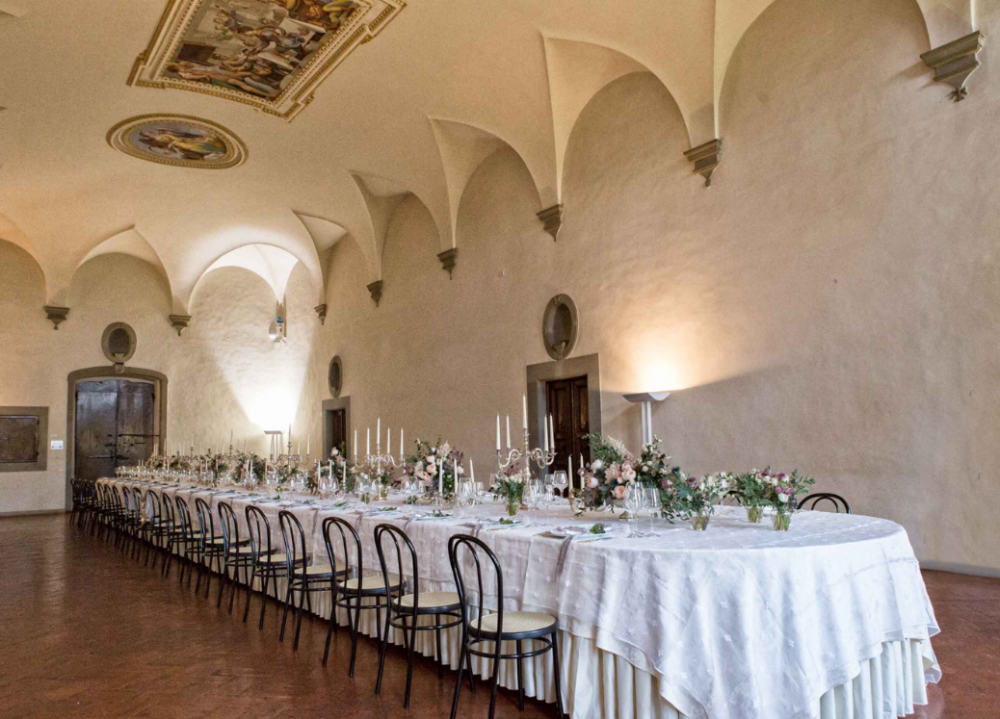 wedding dinner long table setting in a villa medicea in tuscany