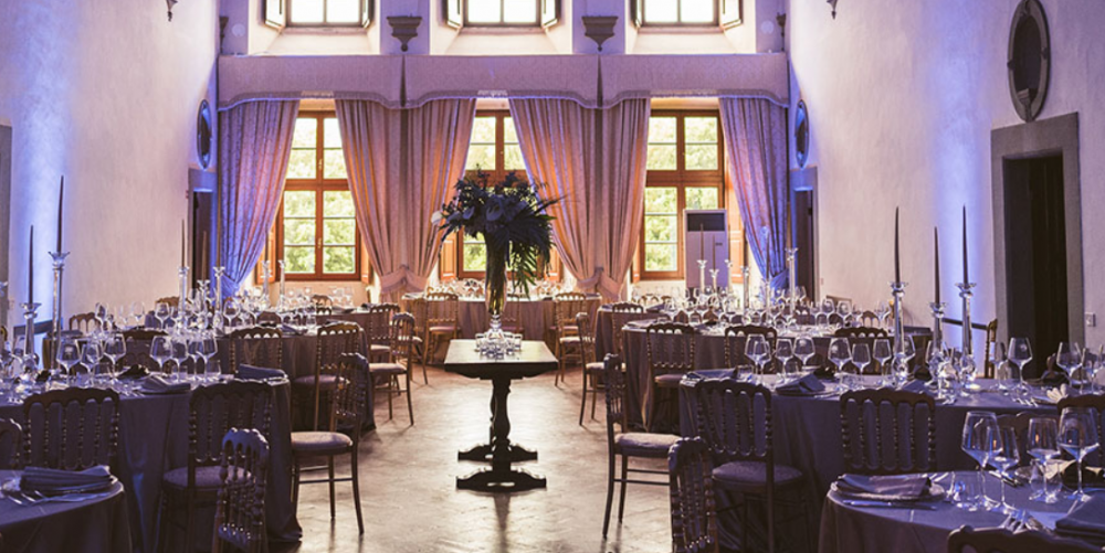 wedding dinner setting in a indoor room of a medici villa in tuscany