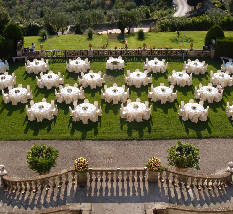 wedding dinner tables setup on the terrace of a villa medicea for weddings in tuscany