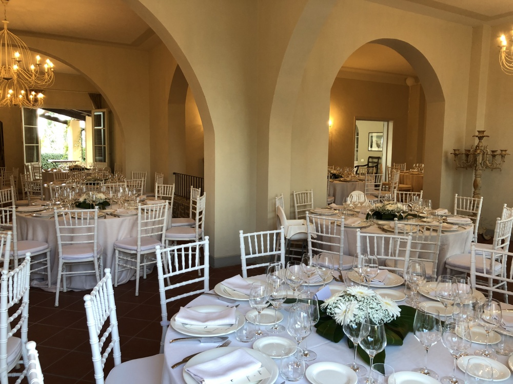 wedding dinner setting in an indoor room in a villa on the tuscan hills