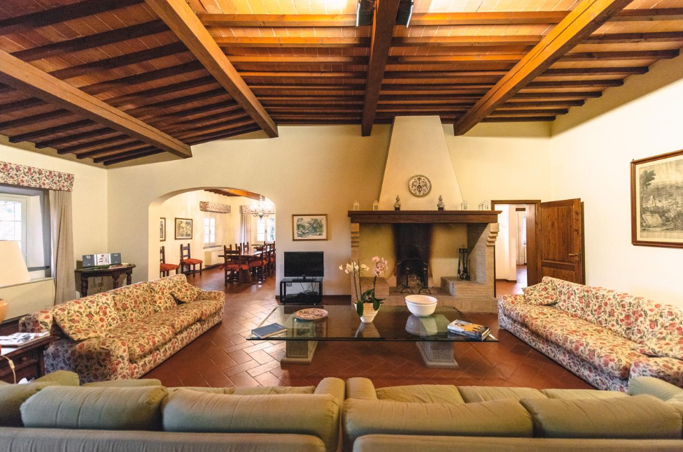 fireplace in the living room of a villa for weddings on the tuscan hills