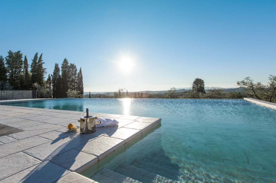 infinity pool with view in a villa for weddings on the tuscan hills