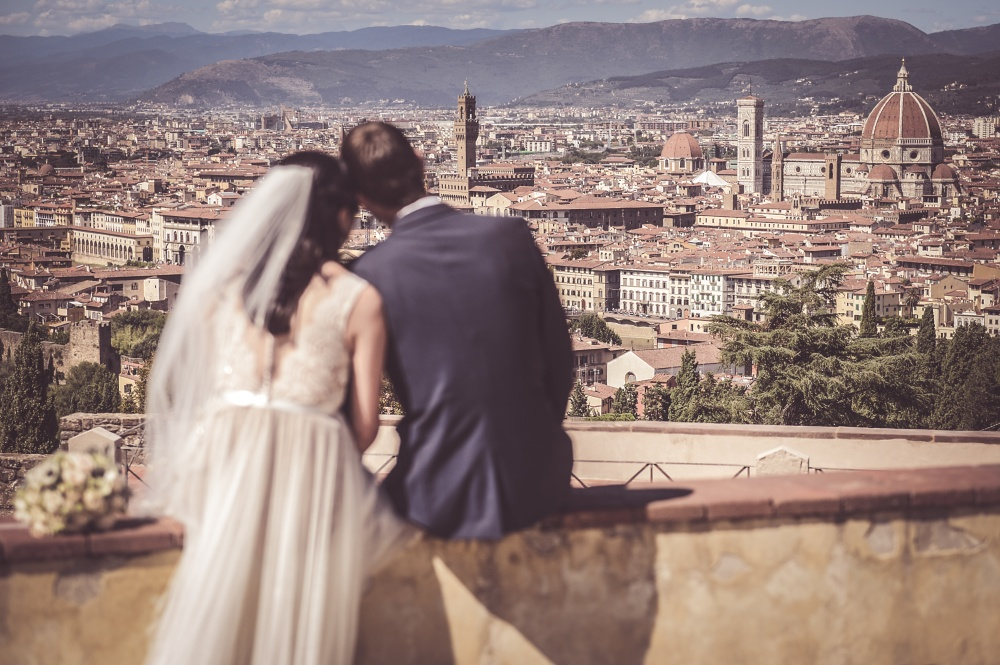 wedding ceremony in florence couple facing the city landscape
