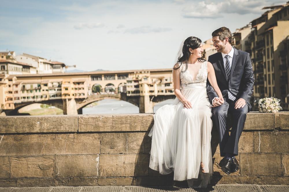 wedding ceremony in florence shooting next to ponte vecchio