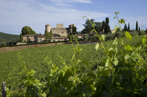wedding venues in chianti front vie of a medieval castle and its gardens