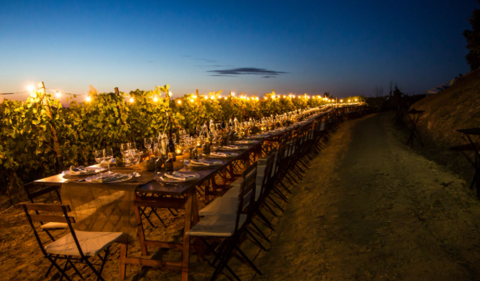 lighting system on the wedding dinner table with vineyards view