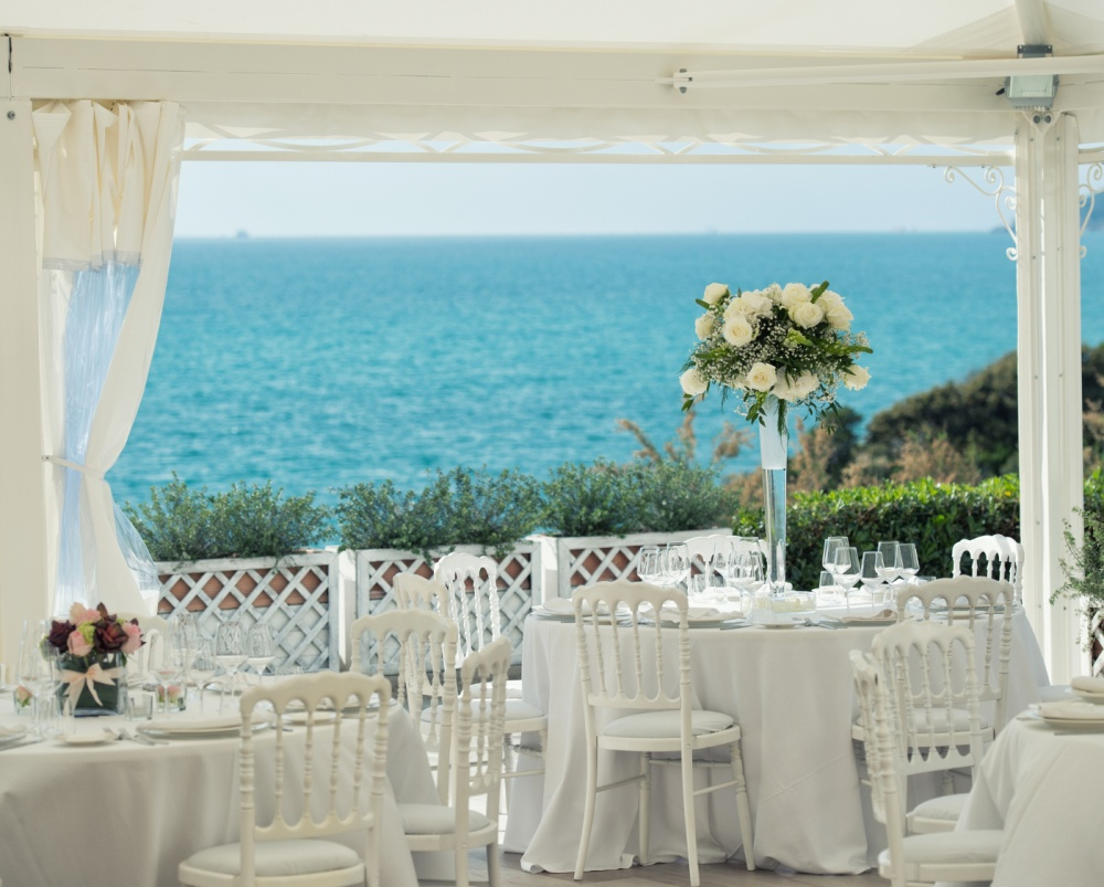 wedding dinner setting in a villa on the sea in tuscany